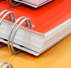 A close up of the notebook spring spine
