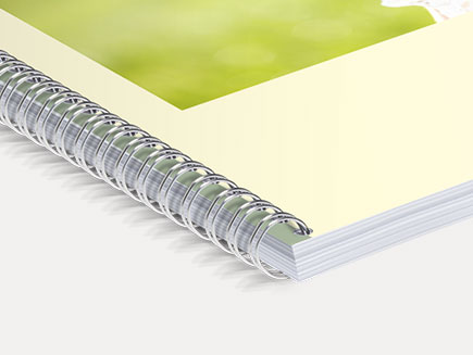 High quality photo album pages bound by spiral spine