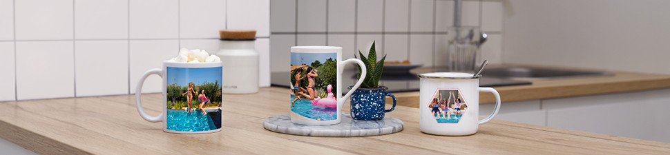 3 different personalised coffee mugs on a table