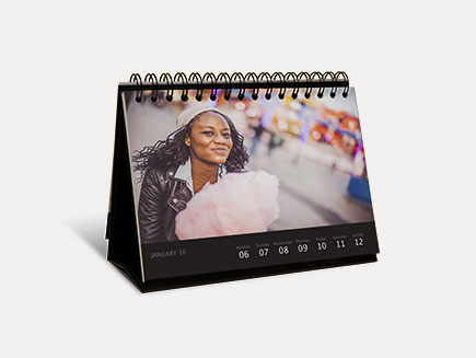deluxe desk calendar on plain background