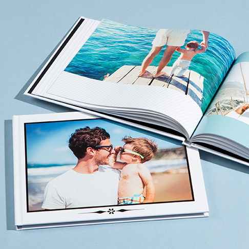 Photo books with family holiday photo displayed