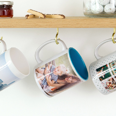 Themed mugs hanging in the kitchen