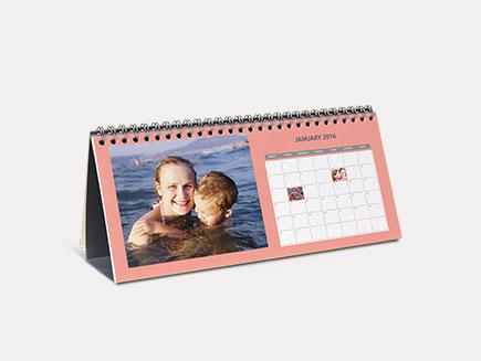 desk calendar on plain background