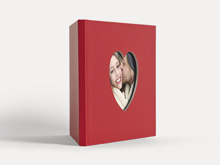 Red hardcovered photobook with heart shaped window